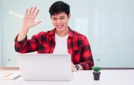 Young Asian man video chatting on a computer