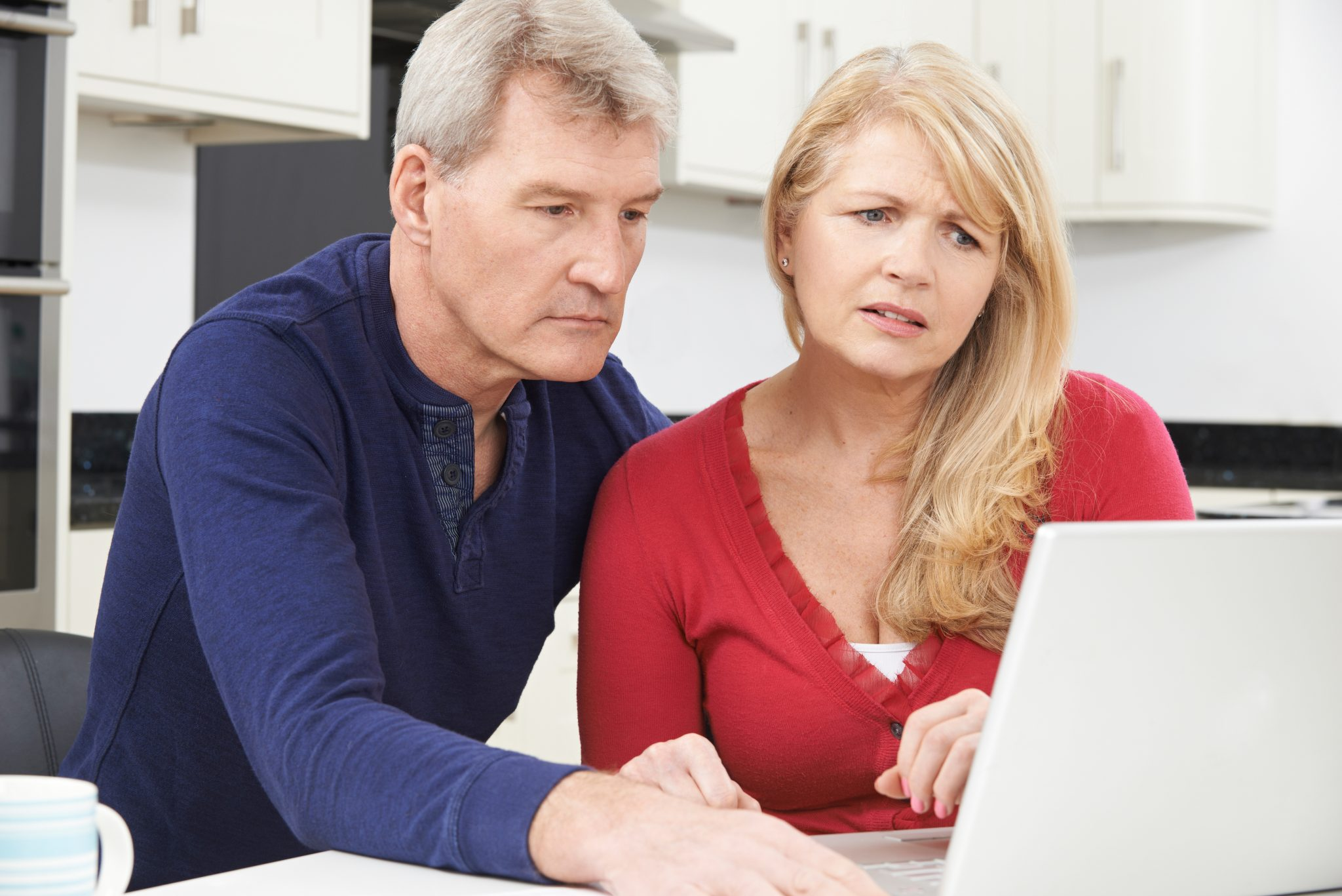 middle aged couple unhappy over bills