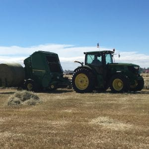 Baling bermudagrass hay in Moultrie GA