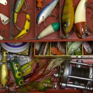 tackle box full of lures, bobbers & more