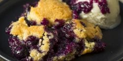 blackberry cobbler and vanilla ice cream are sweet treats to serve at Memorial Day celebrations