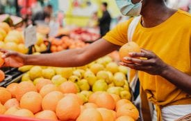 food access survey; food security; African American woman wearing a protective mask while buying groceries at the market