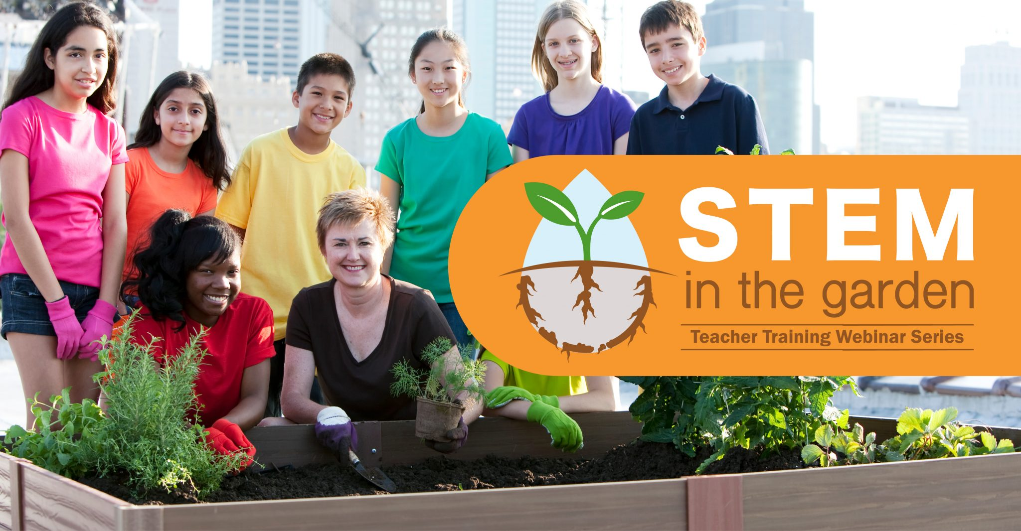 Teacher is with middle school students posing around a raised garden bed in the city.