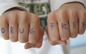 Hands with drug free written across them