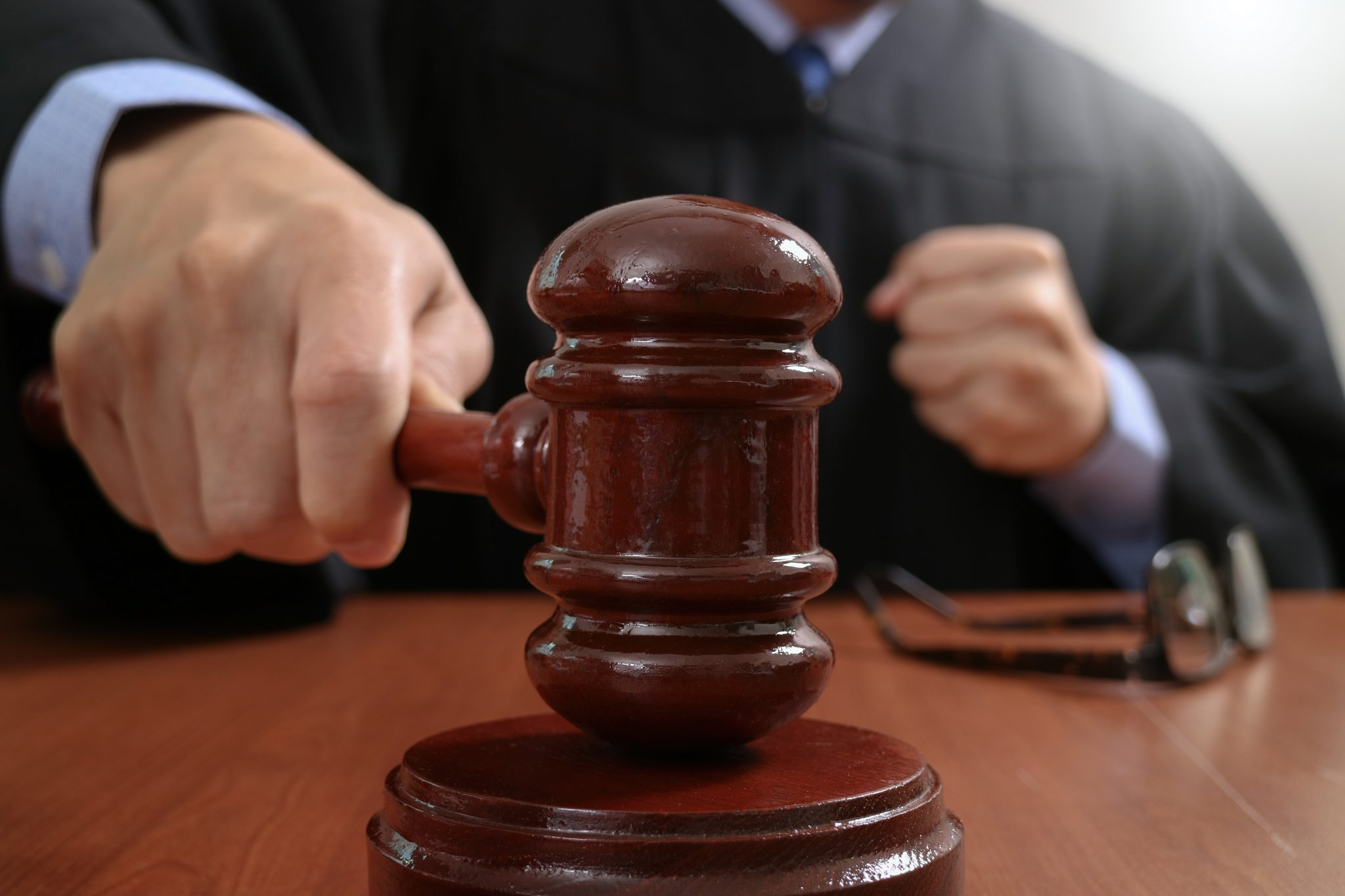 Judge with a gavel in a court room