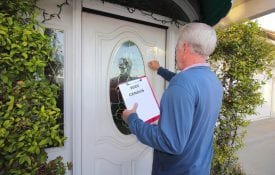A man going door to door collecting information for the 2020 census.