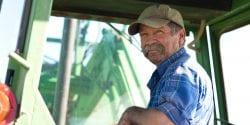 Older farmer in a tractor