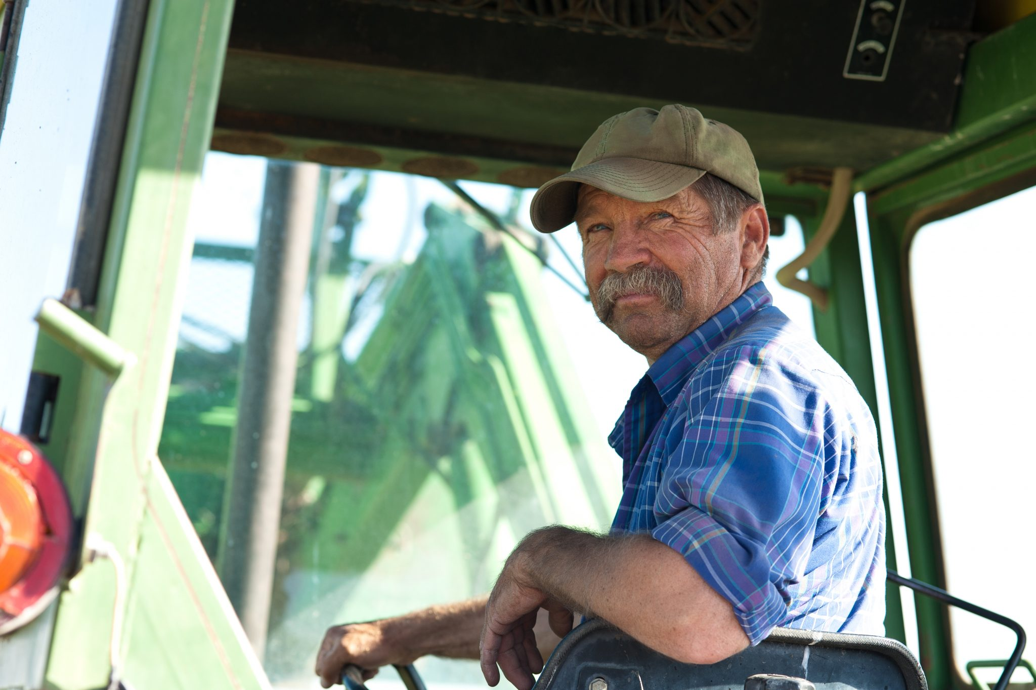 Older farmer in a tractor