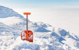 orange shovel in the the snow