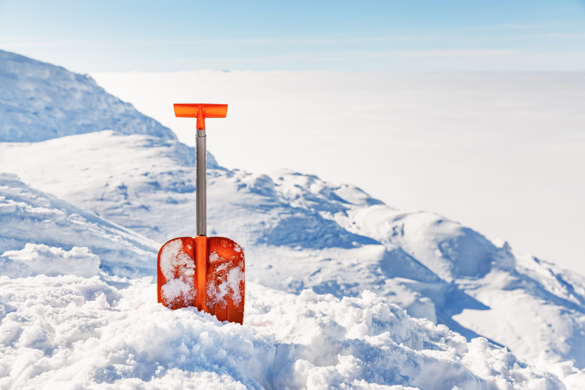 orange shovel in the the snow