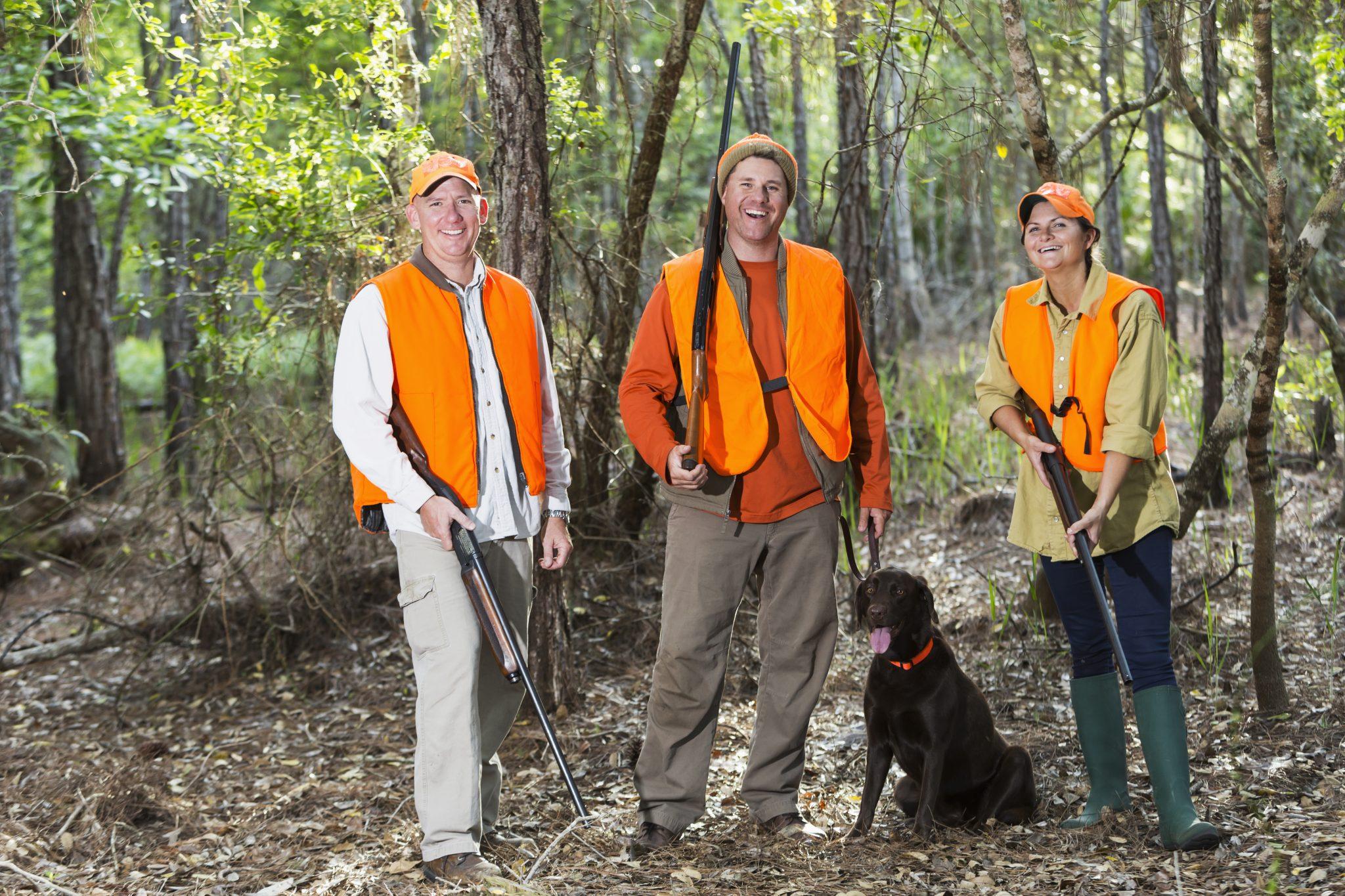 Three hunters with hunting dog