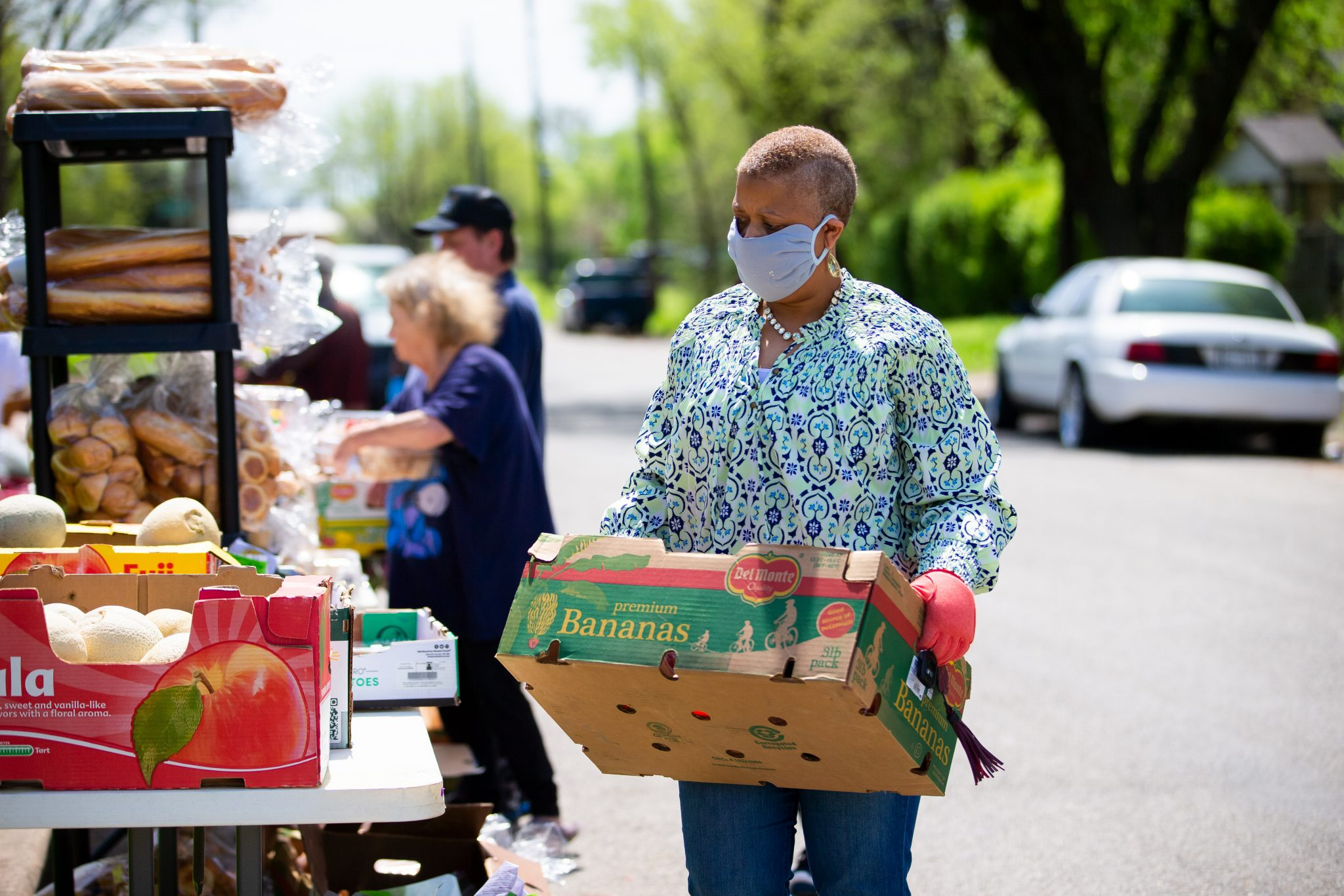 Woman donating food to a food pantry.