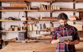 Small business owner in woodworking shop
