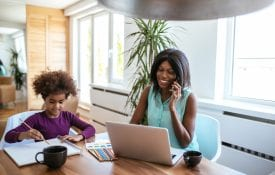 Young mom working from home with child painting