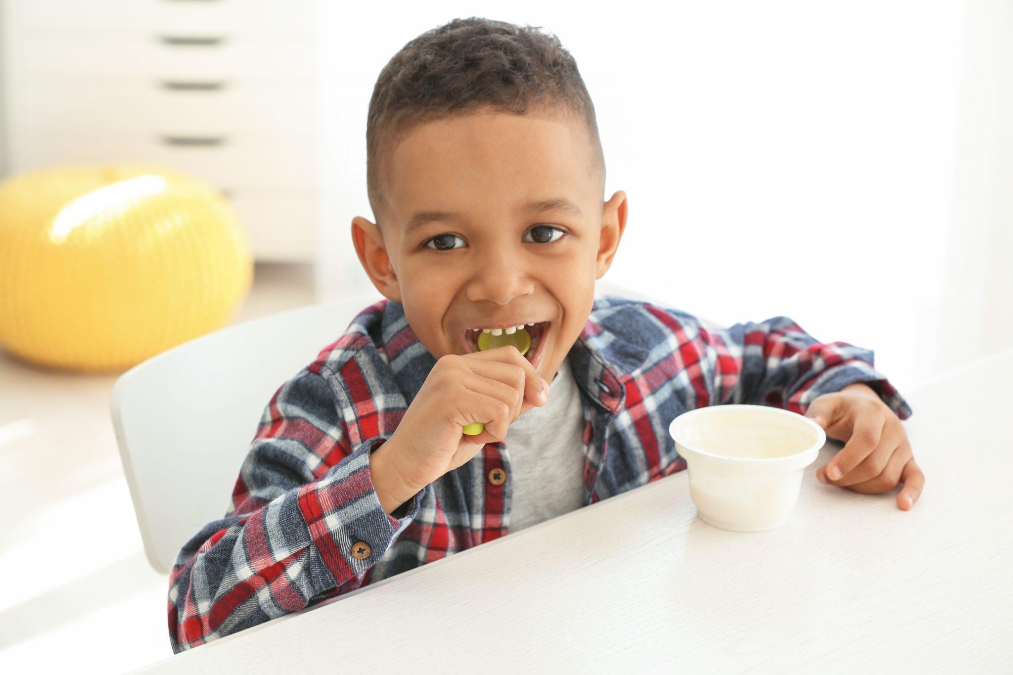African American boy eating breakfast