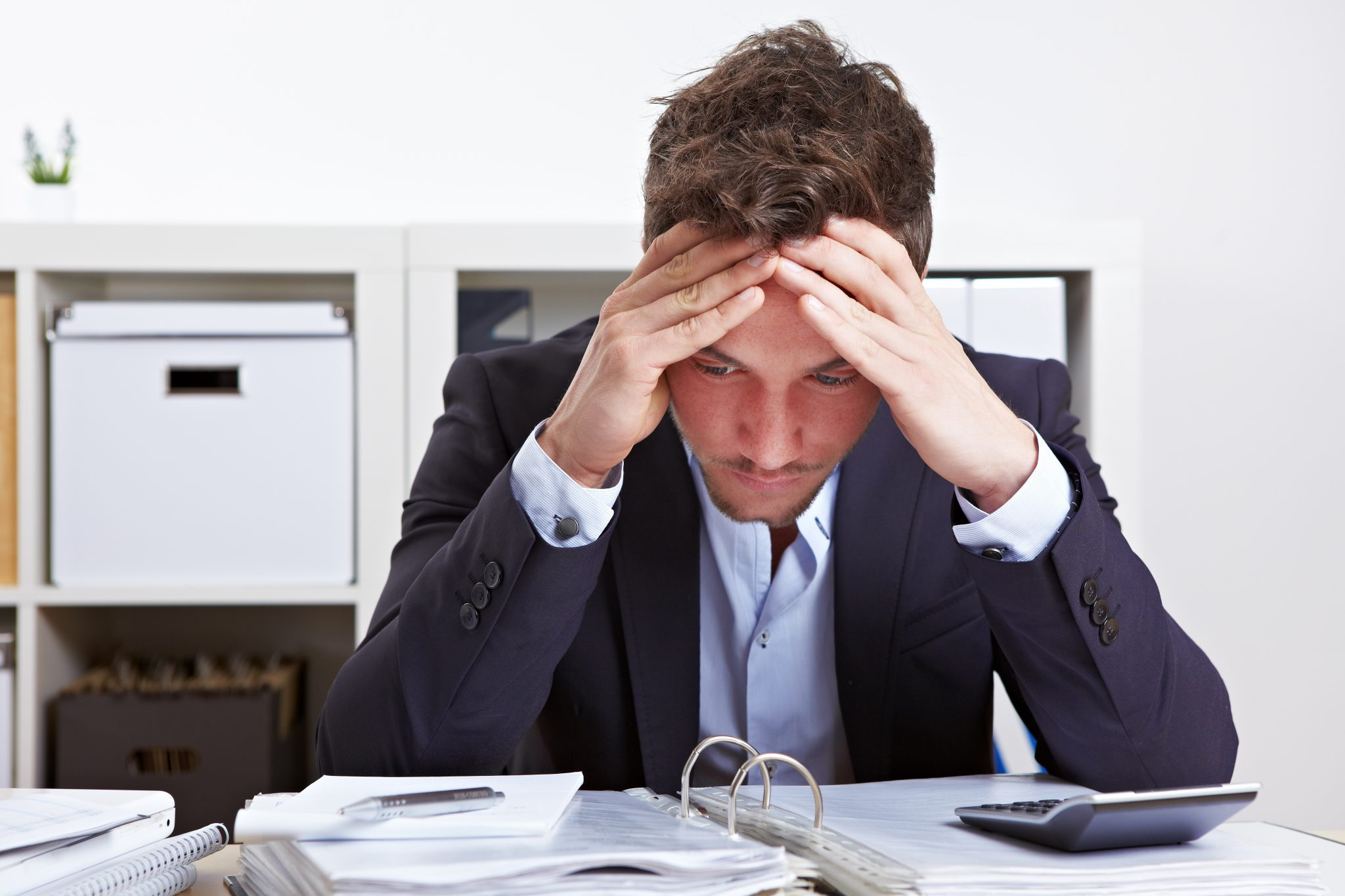 Stressed man in the workplace