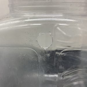 Figure 6. A 3/8-inch hole drilled into the side of the container