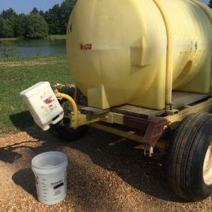 Figure 3. Using a clean container fitted over a boomless nozzle works well as a funnel to determine sprayer output.