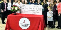 Pictured is the check presentation from the Junior League of the Shoals to the HELP Center in 2019 for $2,000.