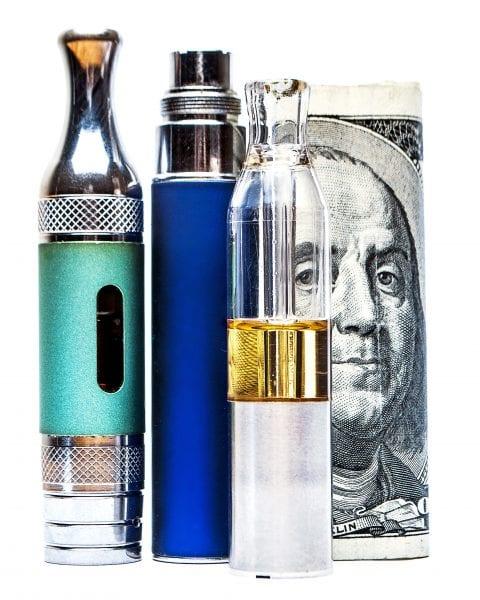 Vape pens with a $100 bill