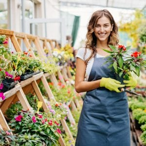 Young woman in a flower center.