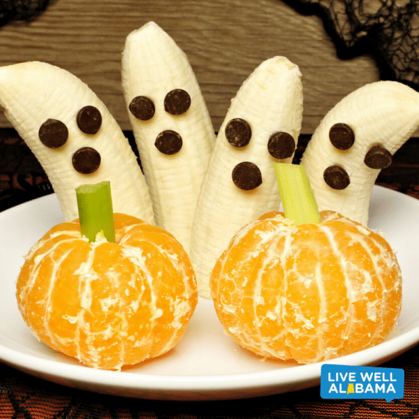 Pumpkins made from oranges and ghosts made from bananas.