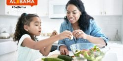 Mother and daughter make meal