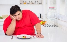 Stressed overweight young man