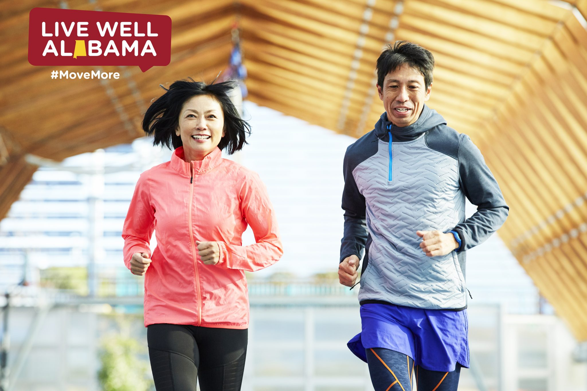 An Asian couple running