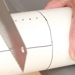 Photo 3. Cutting slits in the stand pipe guard