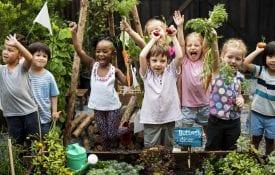 A diverse group of children in a garden