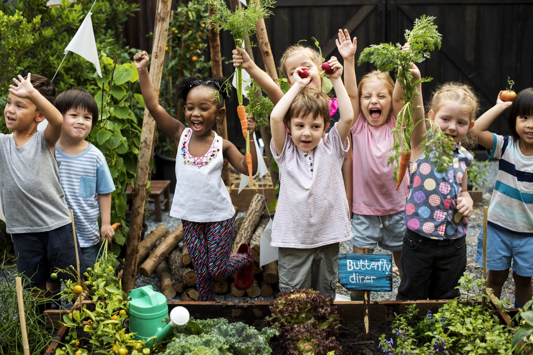 A diverse group of children in a garden