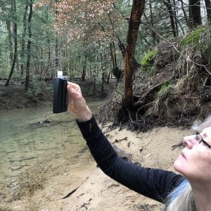 A woman looking at a water sample