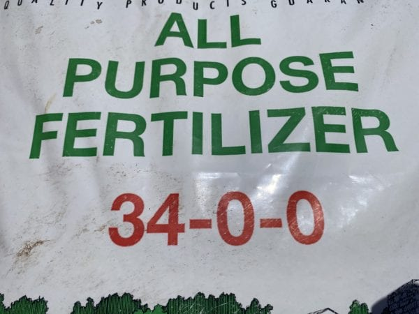 Figure 5. The fertilizer analysis is printed prominently on the bag. This bag of ammonium nitrate contains 34 percent nitrogen. In a 50-pound bag, there would be 17 pounds of nitrogen.