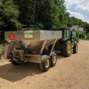 Figure 7. Landowners can rent buggies to spread lime with a hydraulic system tractor.