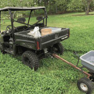 Figure 6a. ATVs and UTVs paired with downsized implements can work well when preparing and amending small or remote plots. A small disc can easily incorporate the pelletized lime and fertilizers that a tow behind spreader distributes. Ag lime is best applied with a tow behind chain-driven or drop spreader as it is too dense for light duty, drive agitated spreaders to distribute.