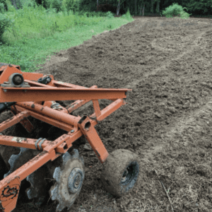 Figure 6b. ATVs and UTVs paired with downsized implements can work well when preparing and amending small or remote plots. A small disc can easily incorporate the pelletized lime and fertilizers that a tow behind spreader distributes. Ag lime is best applied with a tow behind chain-driven or drop spreader as it is too dense for light duty, drive agitated spreaders to distribute.