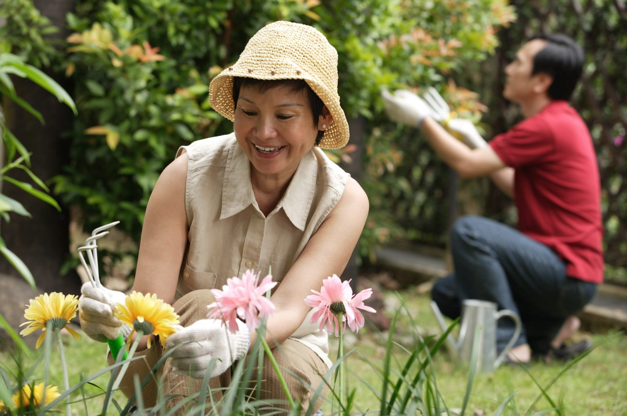 An Asian couple gardening together