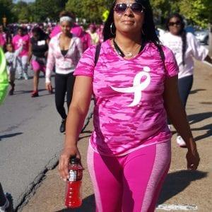 A woman walking in a breast cancer walk.