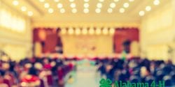 A blurred image of an auditorium