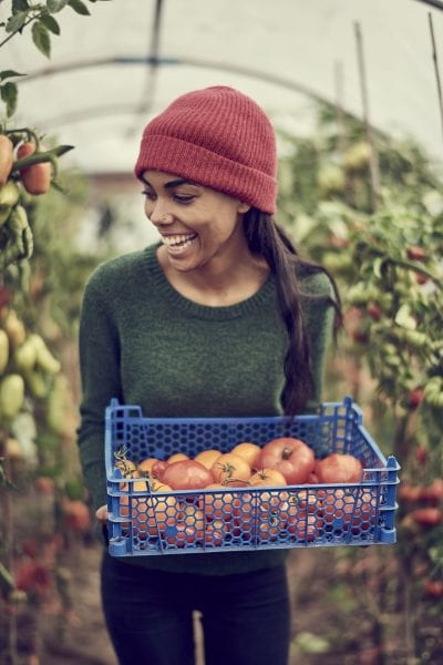 Young female holding tomatoes