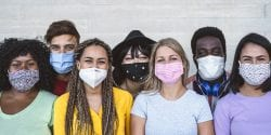 A diverse group of millennials wearing face masks