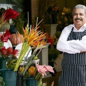Portrait Of Male Florist Outside Shop Smiling To Camera.