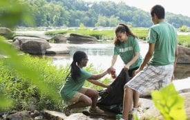 Volunteers cleaning up litter in river