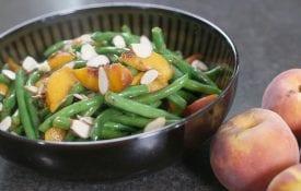 beans, peaches in black bowl