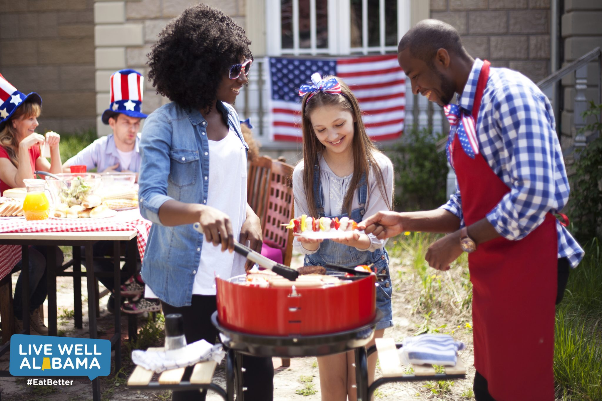 cooking, patriotic clothing, smiling faces