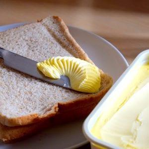 Spreading margarine butter onto bread