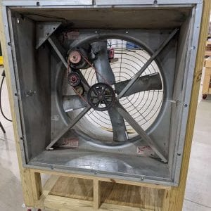 """Figure 2. A 36-inch galvanized fan with cone demonstration unit. The fan has a 1⁄2 hp motor with a switch on the start capacitor to demonstrate a """"working"""" capacitor and a """"dead"""" capacitor. Fan shutters removed for clarity."""