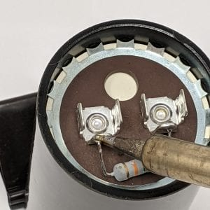 Figure 7b. Unsolder one leg of the resistor with a soldering iron to disconnect the tabs for testing (Figure 7c.).