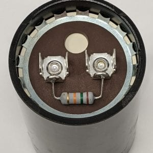 Figure 7a. Some start capacitors come with a bleed-off resistor soldered between the two tabs.